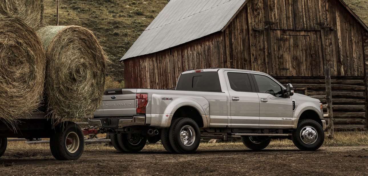 2020 Ford Super Duty towing hay bails