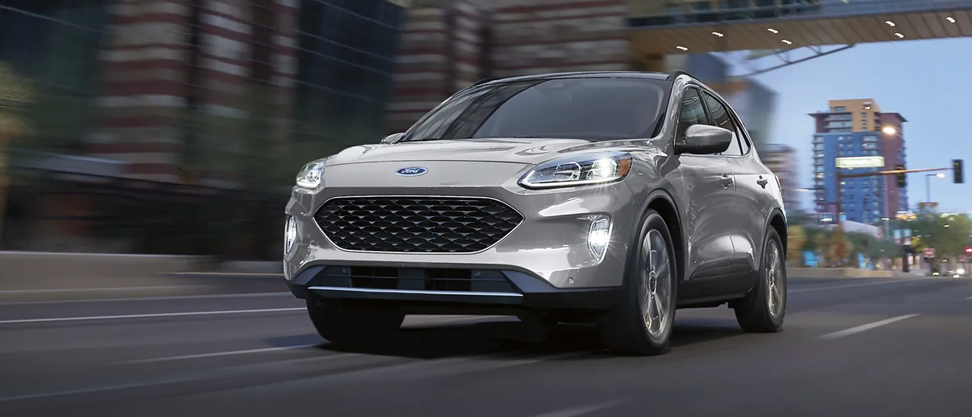 2021 Ford Escape dirving down a city street