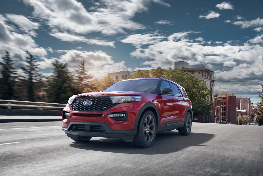 2021 Ford Explorer S T being driven through a small town