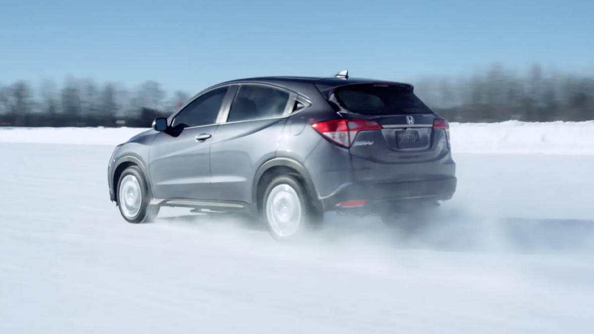 2021 Honda HR-V driving through a snow field.