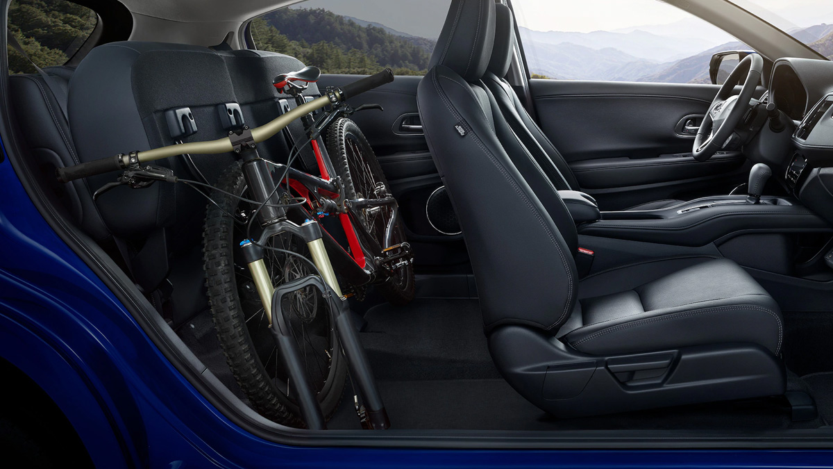 2021 HR-V Interior seating with rear seats folded back with bike placed behind front seats