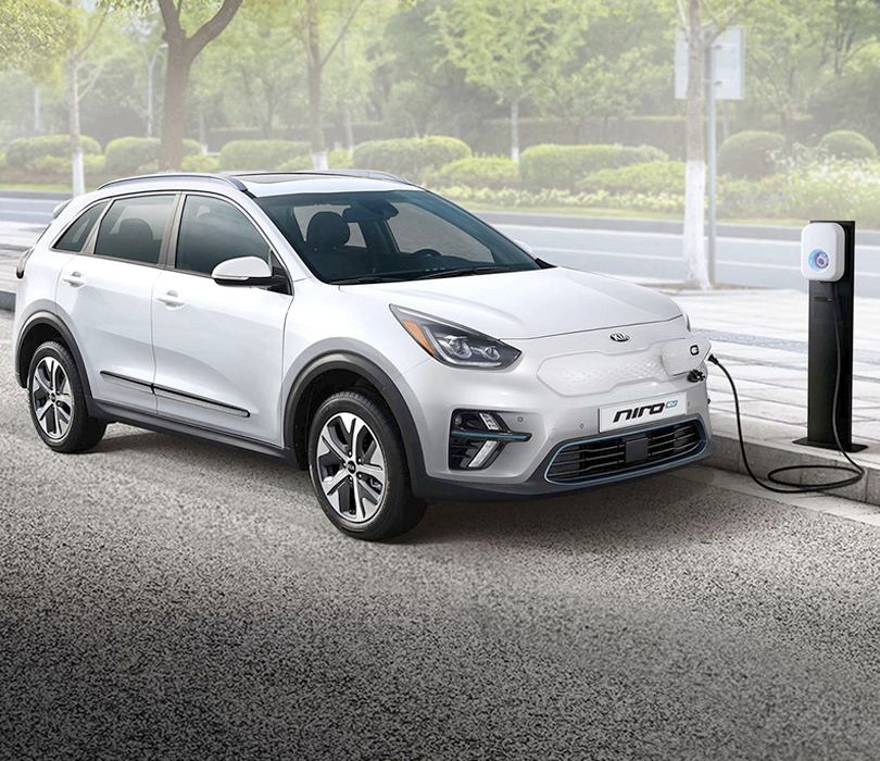 2019 Kia Niro EV powering up at at a charging station