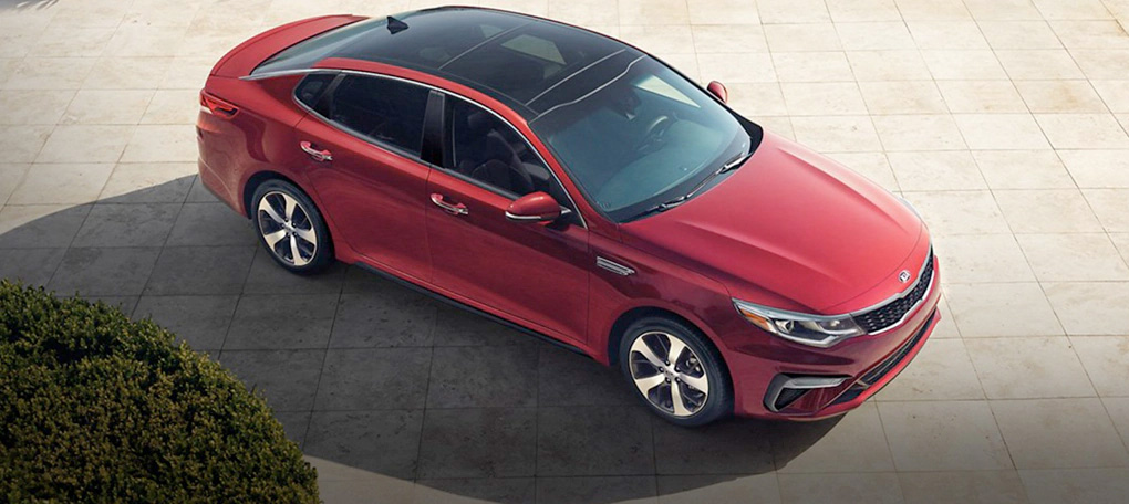Red 2020 Kia Optima with 18-inch wheels and LED headlights