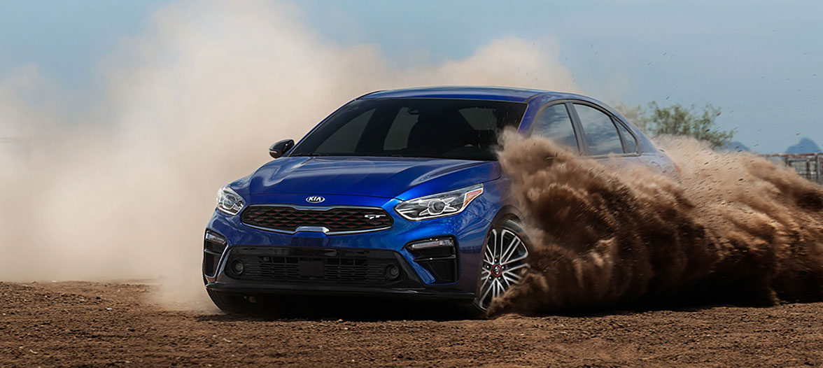 2021 Kia Forte drifting through sand