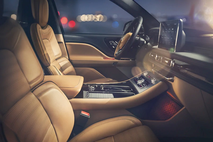 Interior view of the 2021 Lincoln Aviator Black Label SUV with leather seats and mood lighting