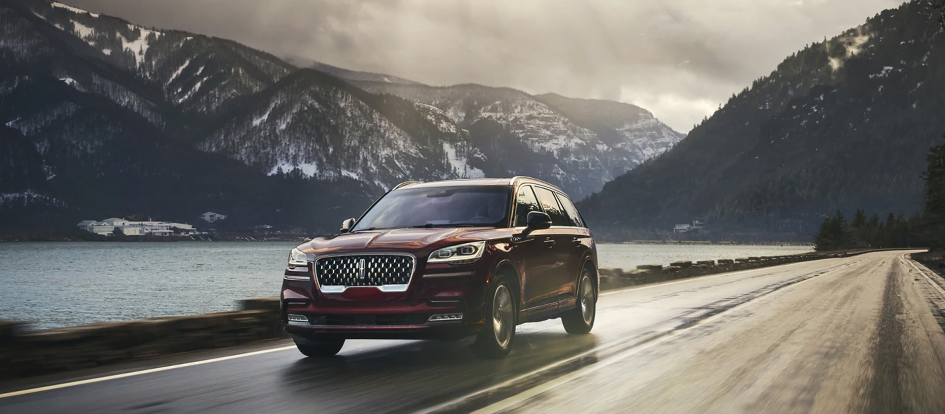 2021 Lincoln Aviator - Driving with snowy mountains in the background