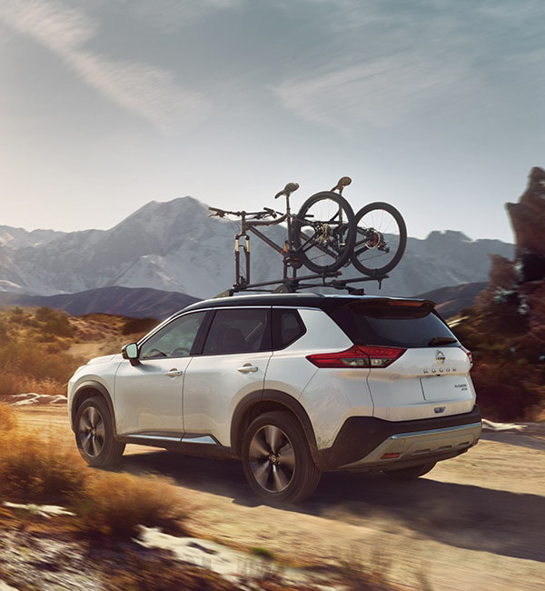 2021 Nissan Rogue off road with bikes on roof rack
