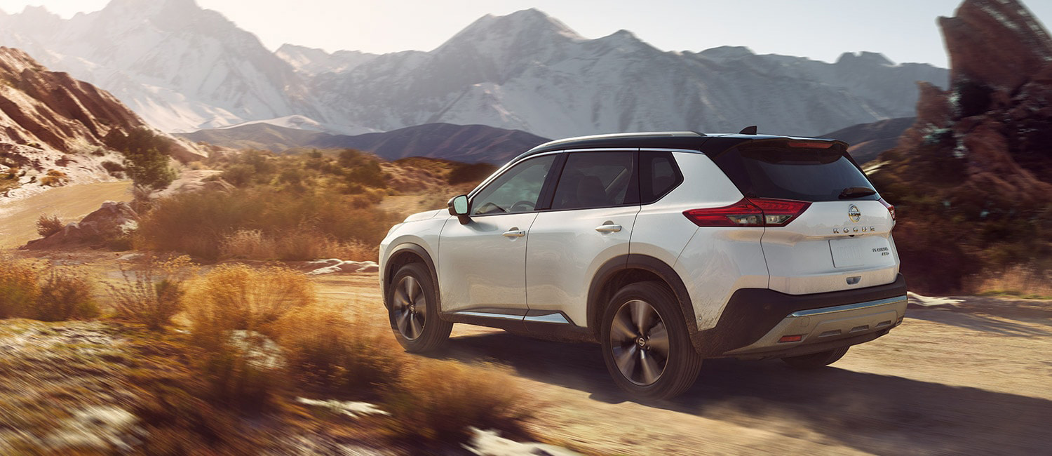 White Nissan Rogue shown off-road