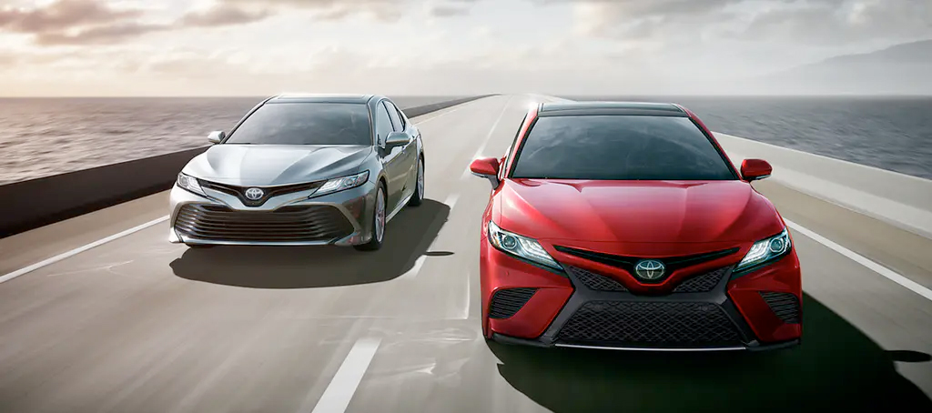 2020 Toyota Camry models driving head on