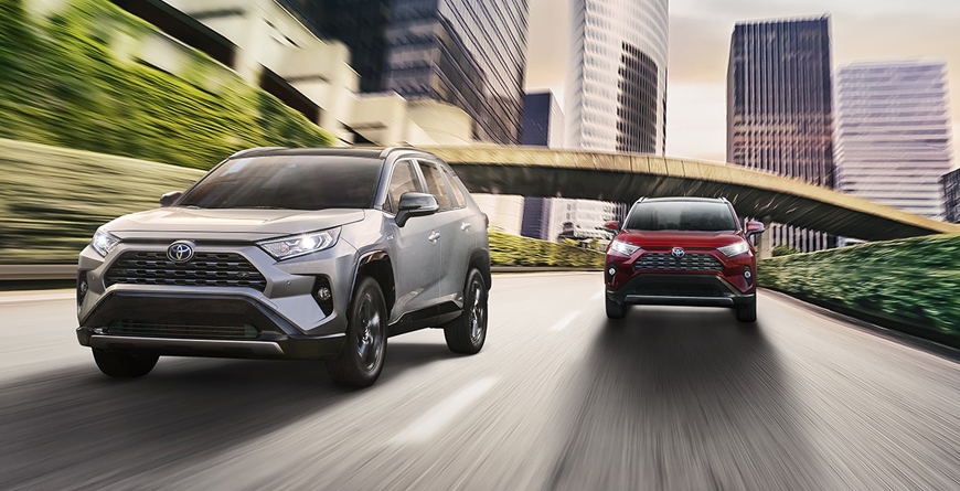 Two Rav4s Driving Down Highway In the City