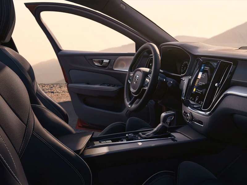 2020 Volvo S60 - Black Interior Shot of Steering Wheel and Dashboard