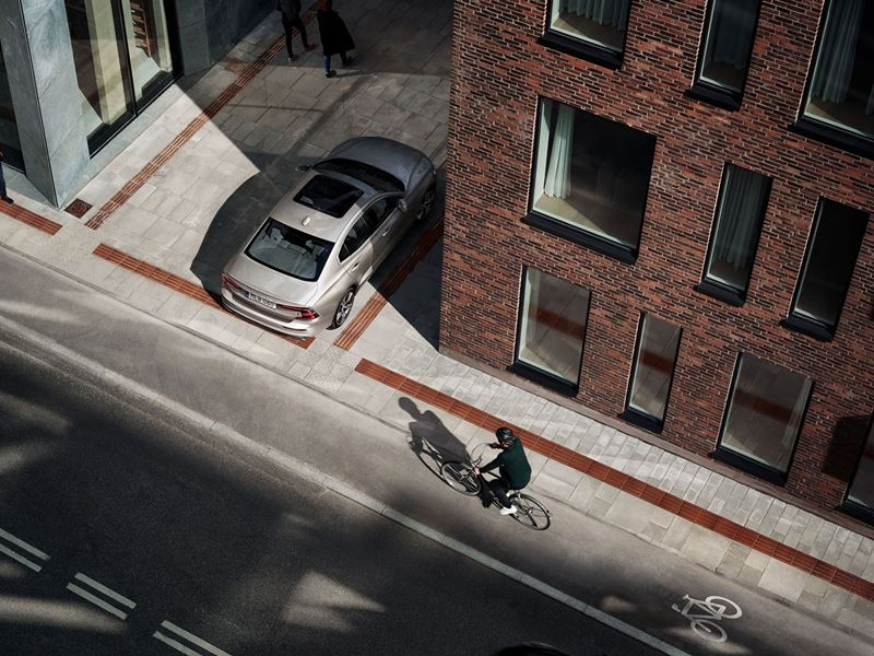 Birds Eye View of 2020 Volvo S60 Backing Out of a parking spoty