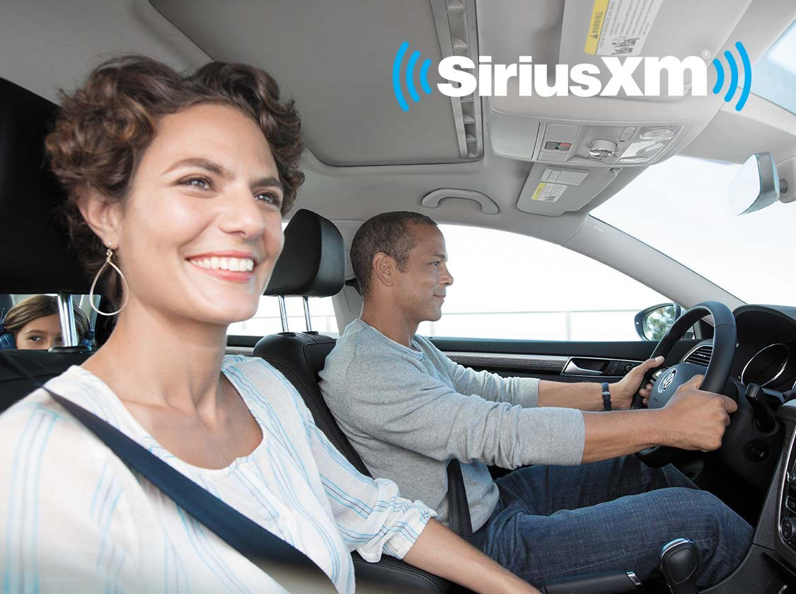 Happy family listening to SiriusXM